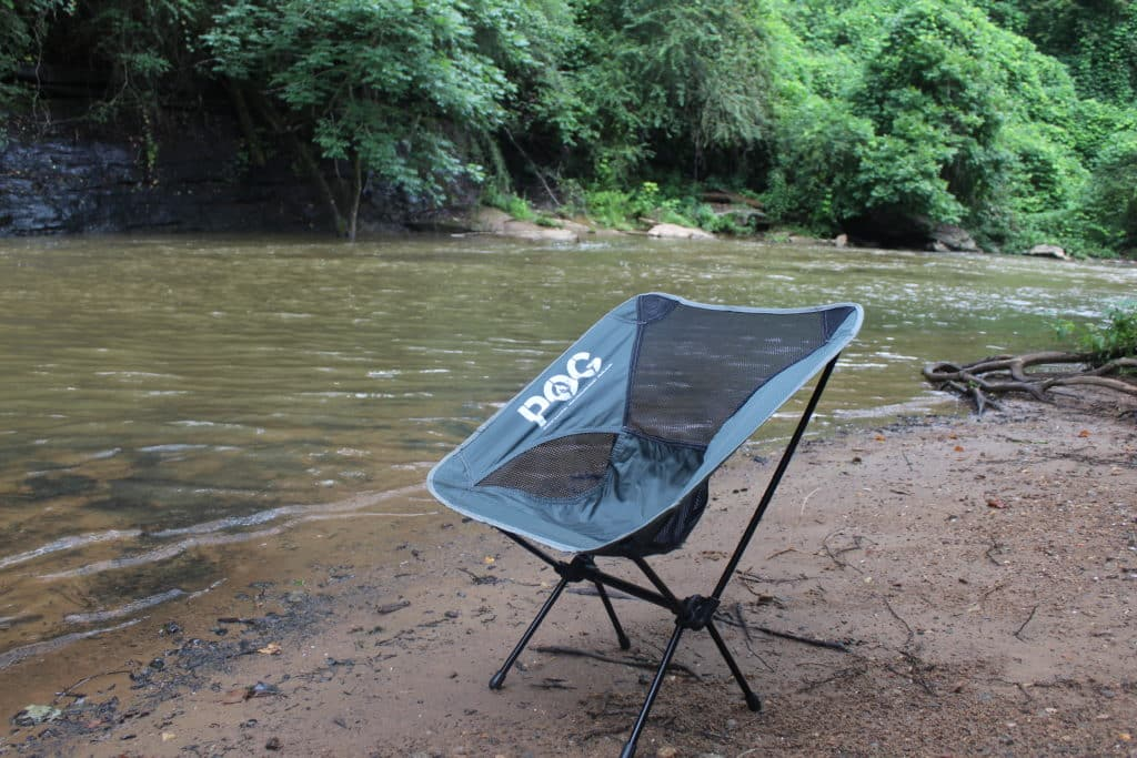Blue POG Lightweight Springer Chair on the Beach by a River