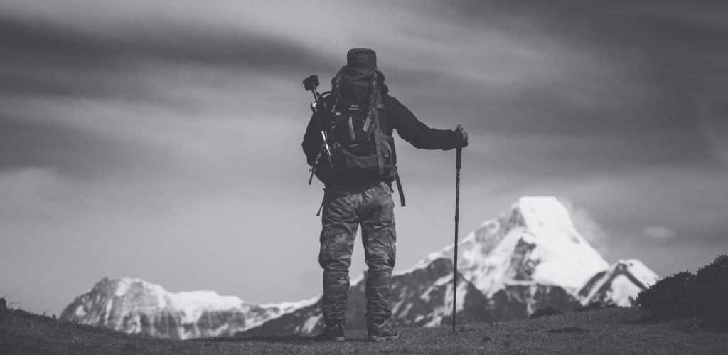 Black and white photo of mountaneer with trekking pole
